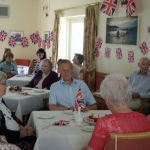 Residents-enjoying-the-cakes-that-were-made-and-decorated-in-house