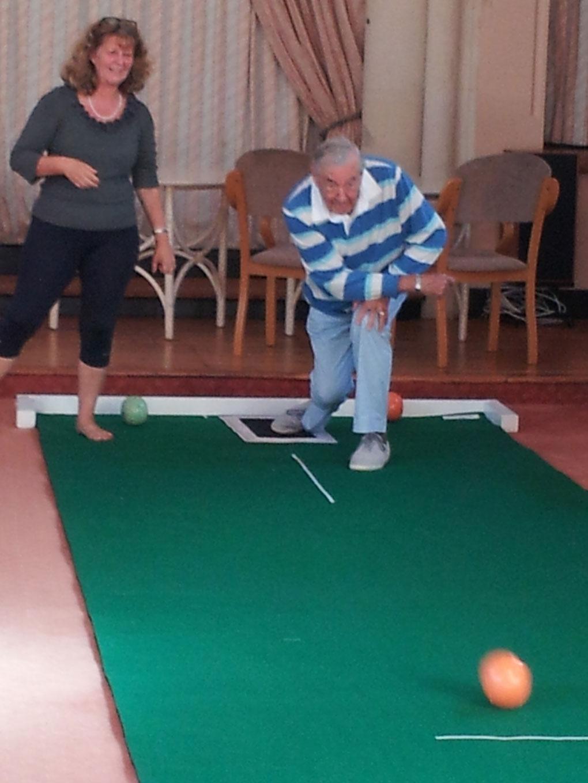 Residents-enjoying-a-demonstration-of-short-mat-bowling
